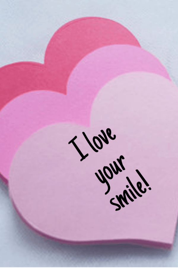 image shows three paper hearts lined up with the words I love your smile