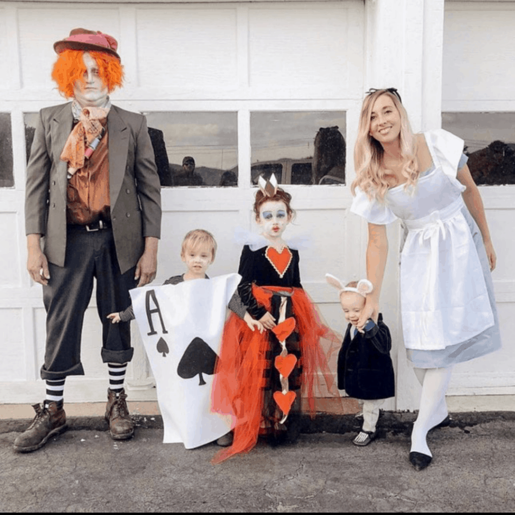 family dressed as alice in wonderland characters