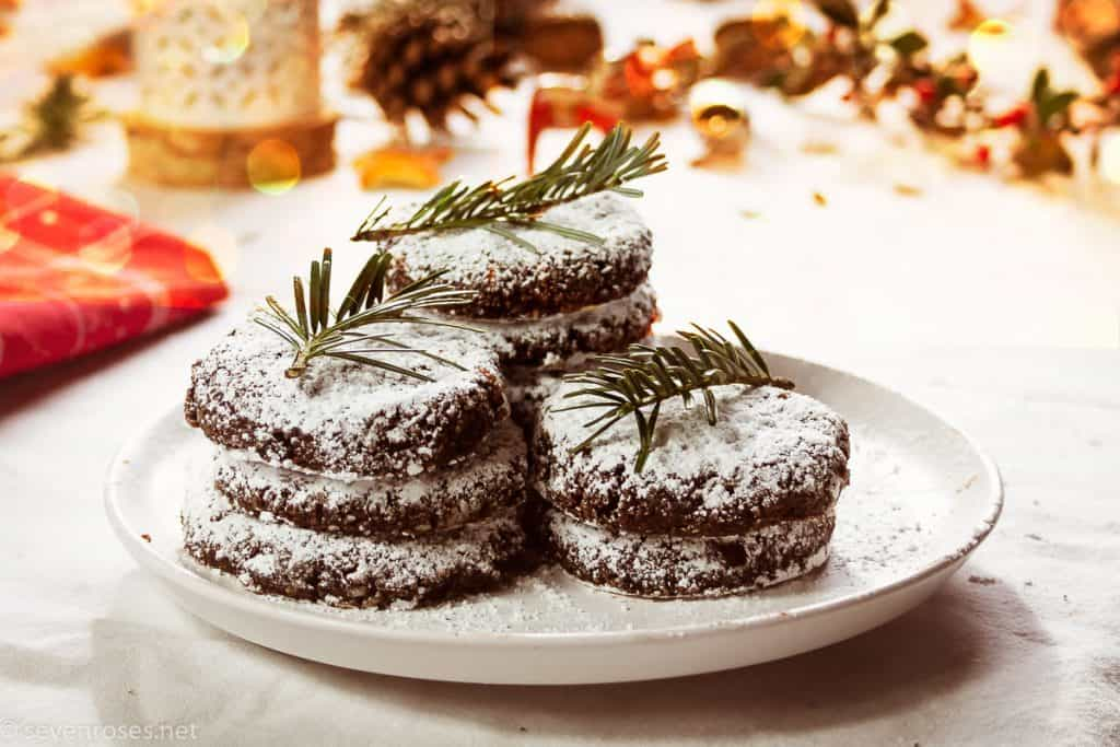 a plate of hazelnut cookies frosted with powdered sugar