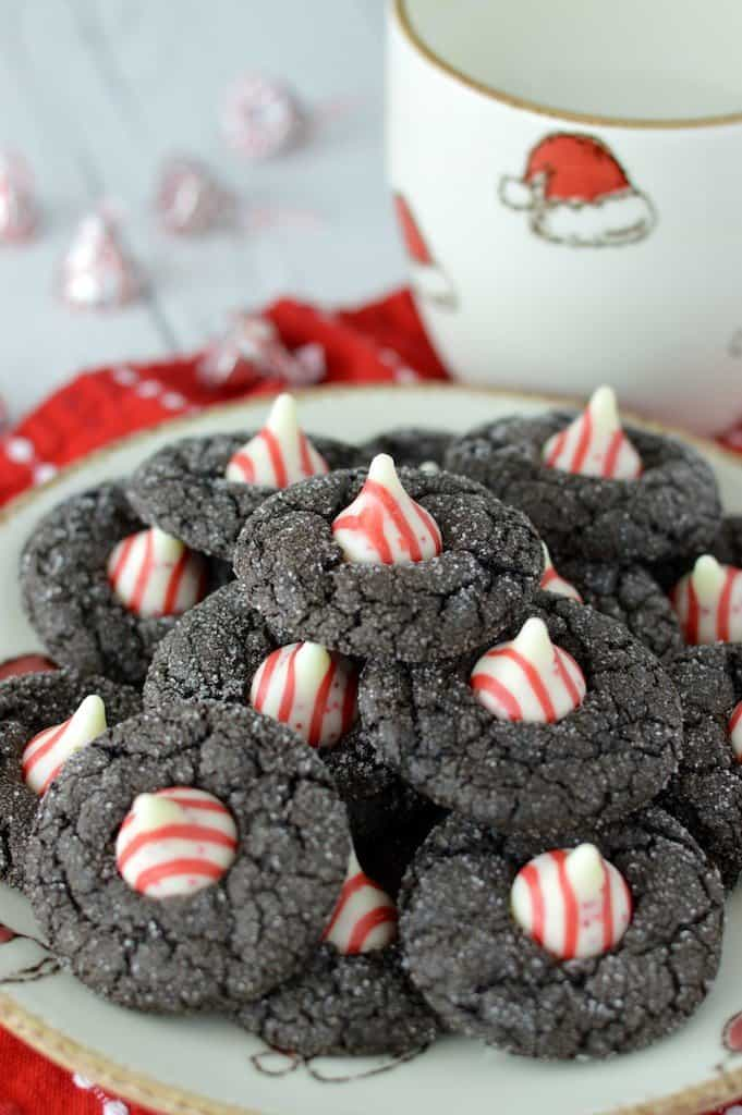 a plate of chocolate cookies with peppermint centers