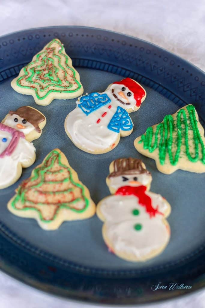a plate of decorated Christmas sugar cookies