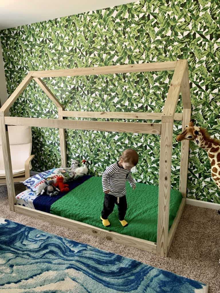child on montessori house bed frame