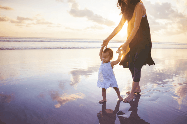 woman and child on beach