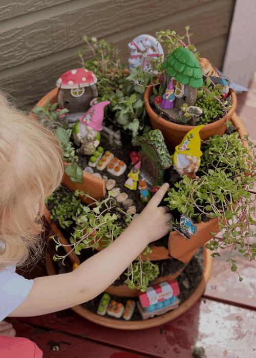 toddler with fairy garden