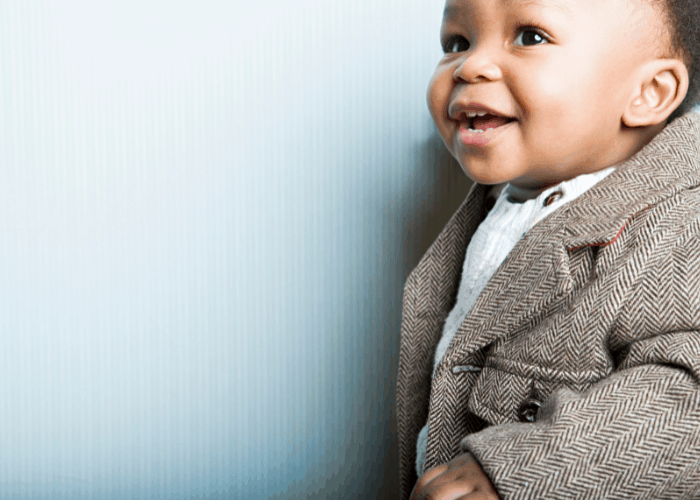 baby in old fashioned clothing