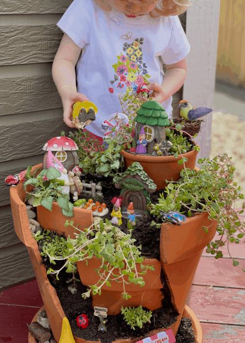 child with broken pot garden
