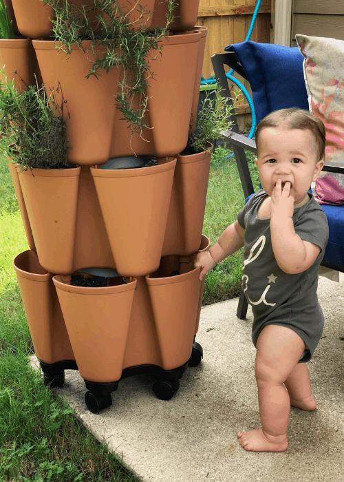 baby with greenstalk planter