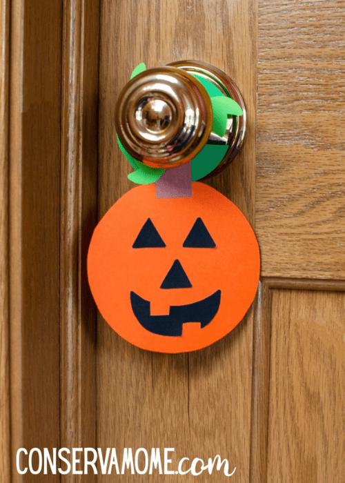 pumpkin hanging from door