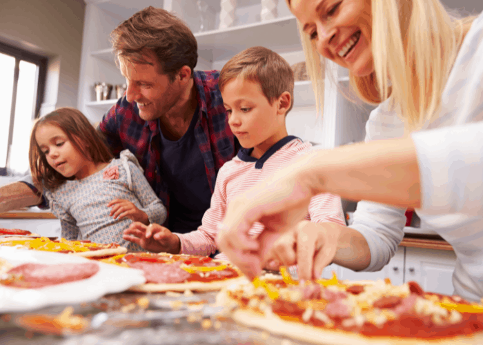 family making pizza
