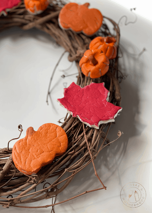 clay pieces on wood wreath