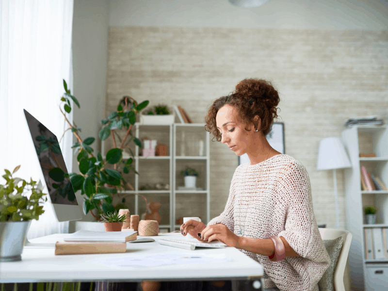 woman working on computer at her desk