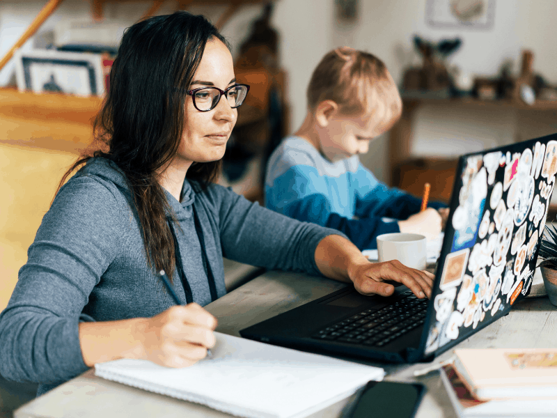 woman with kids using computer