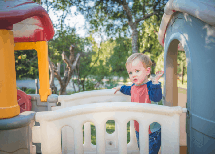 young child on plastic play set