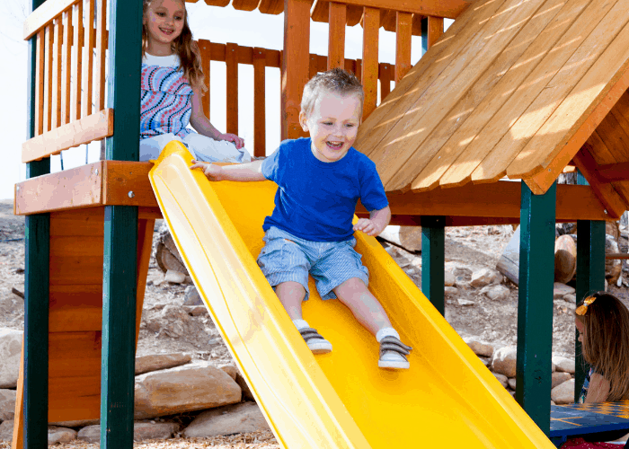 toddlers playing on slide