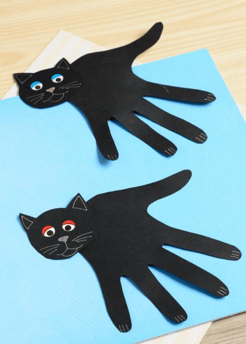 black cat paper handprints